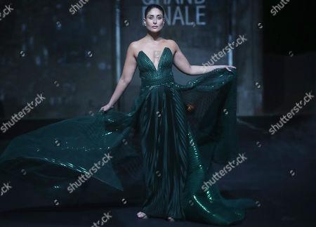Bollywood actress Kareena Kapoor displays a creation by Amit Aggarwal at the grand finale during Lakme Fashion Week in Mumbai, India, Sunday, Feb.16, 2020