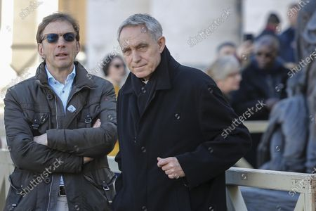 Prefect of the Papal household, Archbishop Georg Gaenswein (R) is seen at the end of Pope Francis' Angelus prayer in St. Peter's Square at the Vatican City, 16 February 2020.