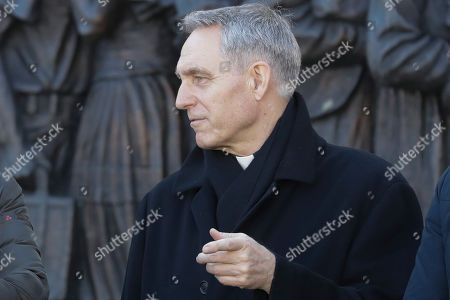 Archbishop Georg Gaenswein walks in St.Peter's Square as he attends Pope Francis' weekly Angelus prayer at the Vatican