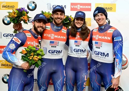 United States's team Jayson Terdiman, left, Chris Mazdzer, second left, Summer Britcher, second right, and Tucker West placed third, celebrate after the World Cup luge relay event in Krasnaya Polyana, near the Black Sea resort of Sochi, southern Russia