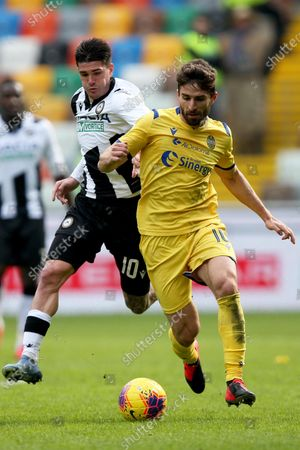 Udinese's Rodrigo De Paul (L) and Verona's Fabio Borini in action during the Italian Serie A soccer match Udinese Calcio vs Hellas Verona FC at the Dacia Arena stadium in Udine, Italy, 16 February 2020.
