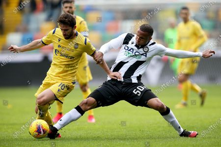 Udinese's Nascimento Becao (R) and Verona's Fabio Borini in action during the Italian Serie A soccer match Udinese Calcio vs Hellas Verona FC at the Dacia Arena stadium in Udine, Italy, 16 February 2020.