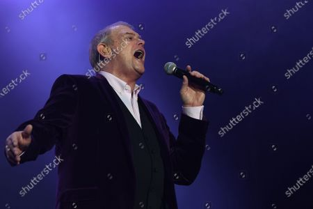 Stock Photo of John Farnham performs during the Fire Fight Australia bushfire relief concert at ANZ Stadium in Sydney, Australia, 16 February 2020. Thousands of people attended the concert, with 10 hours of musical performances, to raise funds for communities devastated by bushfires.