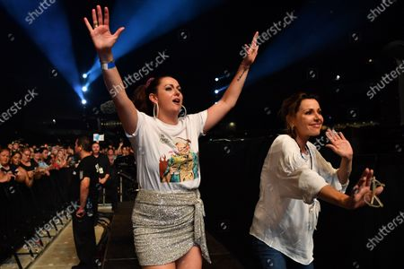 Celeste Barber (L) wearing a shirt featuring Prime Minister Scott Morrison and Tina Arena dance along to John Farnham during the Fire Fight Australia bushfire relief concert at ANZ Stadium in Sydney, Australia, 16 February 2020. Thousands of people attended the concert, with 10 hours of musical performances, to raise funds for communities devastated by bushfires.