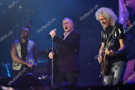 John Farnham (L) and Brian May (R) of Queen perform during the Fire Fight Australia bushfire relief concert at ANZ Stadium in Sydney, Australia, 16 February 2020. Thousands of people attended the concert, with 10 hours of musical performances, to raise funds for communities devastated by bushfires.