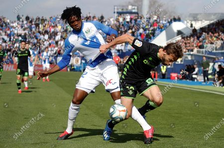 Nigerian Leganes´s defender Chidozie Collins Awaziem (L) and Sevilla´s midfielder Sergio Canales (R) during the Spanish LaLiga match between Leganes and Betis, at Municipal stadium of Butarque (Leganes), center Spain, 16  February 2020.