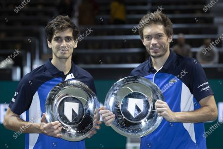 Stock Picture of Pierre-Hugues Herbert (L) and Nicolas Mahut from France after winning their match against Henri Kontinen (Finland) and Jan-Lennard Struff (Germany) in the doubles final of the ABN AMRO World Tennis Tournament, in Rotterdam, Netherlands, 16 February 2020.