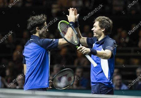Stock Image of Pierre-Hugues Herbert (L) and Nicolas Mahut from France win their match against Henri Kontinen (Finland) and Jan-Lennard Struff (Germany) in the doubles final of the ABN AMRO World Tennis Tournament, in Rotterdam, Netherlands, 16 February 2020.