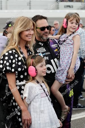 Jimmie Johnson, Chandra Janway. Jimmie Johnson, center, gathers next to his car with his wife Chandra Janway, left, and children Genevieve, front left, and Lydia, right, before the NASCAR Daytona 500 auto race at Daytona International Speedway, in Daytona Beach, Fla