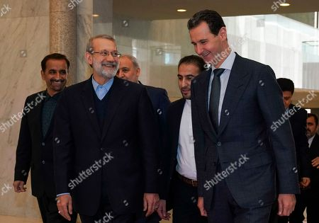 Bashar Assad, Ali Larijani. In this photo released by the Syrian official news agency SANA, Syrian President Bashar Assad, right, speaks to Iran's Parliament Speaker Ali Larijani, in Damascus, Syria