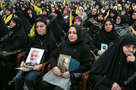 Supporters of Hezbollah hold photos of slain Iranian general Qasem Soleimani as they listen to a speech by Hezbollah leader Sayyed Hassan Nasrallah delivered on a screen during a rally to mark the Martyrs leaders Day at southern suburb Beirut, Lebanon, 16 February 2020. According to reports, the gathering was organized by Hezbollah in commemoration of the Martyrs Day, to mark the death of Sayyed Abbas Mousawi on 16 February 1992, Sheikh Ragheb Harb Ragheb Harb killed 16 February 1984 and Hajj Imad Moghnieh killed 12 February 2008 in Damascus.