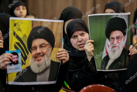 Supporter of Hezbollah hold photos of Hezbollah leader Hassan Nasrallah (L) and Supreme Iranian leader Ali Khamenei (R) during a rally to mark the Martyrs leaders Day at southern suburb Beirut, Lebanon, 16 February 2020. According to reports, the gathering was organized by Hezbollah in commemoration of the Martyrs Day, to mark the death of Sayyed Abbas Mousawi on 16 February 1992, Sheikh Ragheb Harb Ragheb Harb killed 16 February 1984 and Hajj Imad Moghnieh killed 12 February 2008 in Damascus.