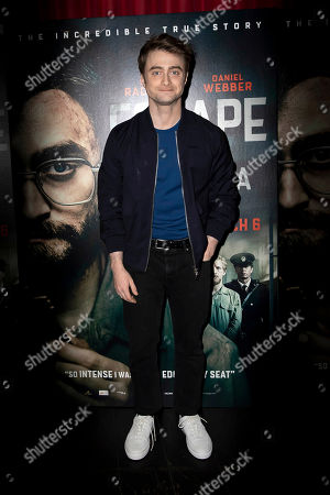 Daniel Radcliffe poses for photographers on arrival at a screening of the film 'Escape From Pretoria' in London