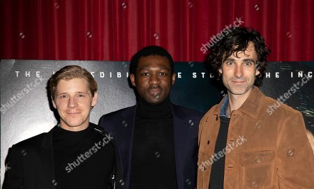 Stock Image of Daniel Webber, Francis Annan, Mark Leonard Winter. From Left, actor Daniel Webber, director Francis Annan and actor Mark Leonard Winter, pose for photographers on arrival at a screening of the film 'Escape From Pretoria' in London