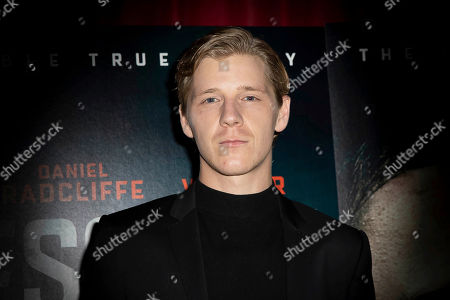 Stock Photo of Daniel Webber poses for photographers upon arrival at a screening of the film 'Escape From Pretoria' in London
