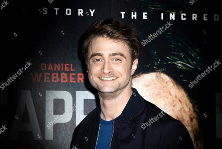 Daniel Radcliffe poses for photographers upon arrival at a screening of the film 'Escape From Pretoria' in London