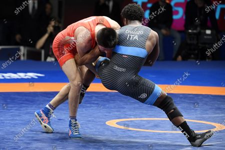 Frank Chamizo Marquez of Italy (in blue) and Magomedrasul Gazimagomedov of Russia fight in the final match of the men's freestyle 74kg weight category of the European Wrestling Championships in Rome, Italy, 16 February 2020.