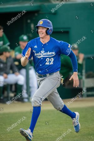 UC Santa Barbara's Kyle Johnson is the winning run against Sacramento State in a 1-0 victory for the Gauchos during an NCAA baseball game, in Sacramento, Calif