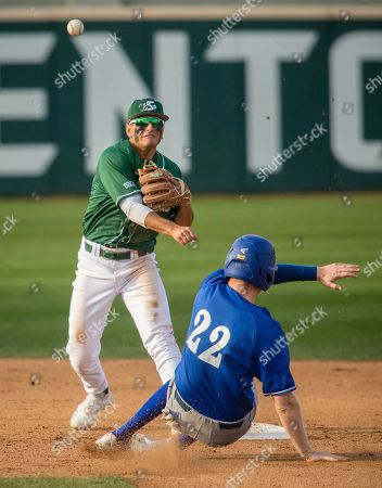 Sac State's Jorge Bojorquez makes and celebrates a double-play against UC Santa Barbara's as Kyle Johnson is out during the play. UCSB beat Sacramento State in a 1-0 victory during an NCAA baseball game, in Sacramento, Calif