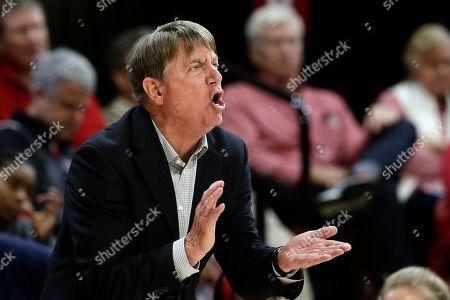 North Carolina State coach Wes Moore yells to players during the second half of an NCAA college basketball game against Georgia Tech in Raleigh, N.C