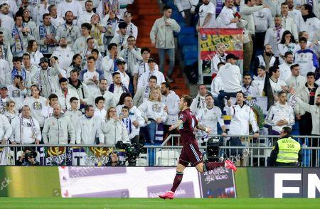 Celta Vigo's Fyodor Smolov celebrates scoring the opening goal during the Spanish La Liga soccer match between Real Madrid and Celta de Vigo at the Santiago Bernabeu stadium in Madrid, Spain