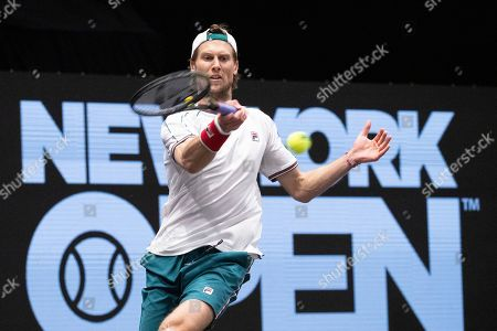 Andreas Seppi, of Italy, returns a shot to Kyle Edmund, of Britain, in the final of the New York Open tennis tournament in Uniondale, N.Y