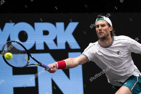 Andreas Seppi, of Italy, reaches for a shot to Kyle Edmund, of Britain, in the finals of the New York Open tennis tournament, in Uniondale, N.Y