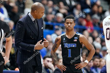 """Memphis head coach Anfernee """"Penny"""" Hardaway, left, talks with Tyler Harris, right, in the second half of an NCAA college basketball game, against Connecticut, in Hartford, Conn"""