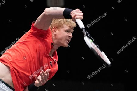 Kyle Edmund, of Britain, serves against Andreas Seppi, of Italy, in the finals of the New York Open tennis tournament, in Uniondale, N.Y