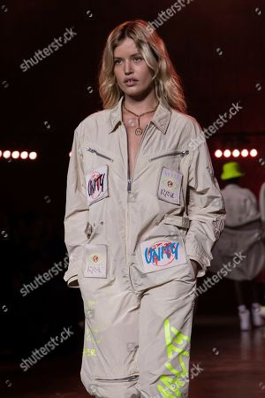 Georgia May Jagger wears a creation by designer Tommy Hilfiger at the Autumn/Winter 2020 fashion week runway show in London