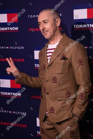 Alan Cumming poses for photographers ahead of the Tommy Hilfiger Autumn/Winter 2020 fashion week runway show in London
