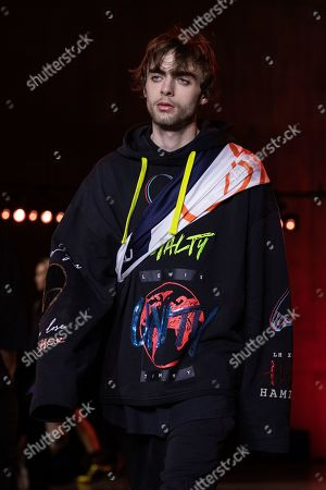 Stock Image of Lennon Gallagher wears a creation by designer Tommy Hilfiger at the Autumn/Winter 2020 fashion week runway show in London