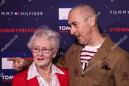 Alan Cumming, Mary Darling. Alan Cumming and mother Mary Darling pose for photographers ahead of the Tommy Hilfiger Autumn/Winter 2020 fashion week runway show in London