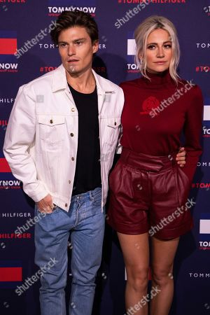 Oliver Cheshire, Pixie Lott. Oliver Cheshire and Pixie Lott pose for photographers ahead of the Tommy Hilfiger Autumn/Winter 2020 fashion week runway show in London