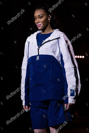 Winnie Harlow wears a creation by designer Tommy Hilfiger at the Autumn/Winter 2020 fashion week runway show in London