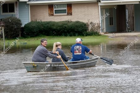 Stock Image of Dale Frazier, John Smith, Jina Smith. Dale Frazier, left, and his neighbors John and Jina Smith paddle across Pearl River floodwater to their Flowood, Miss., homes, . Because Frazier's home is slightly elevated, he was hoping no water would enter.Residents of Jackson braced Sunday for the possibility of catastrophic flooding in and around the Mississippi capital as the Pearl River rose precipitously after days of torrential rain
