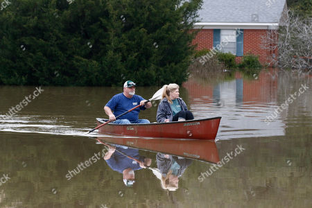 John Smith, Jina Smith. John and Jina Smith paddle away from their Flowood, Miss., home, as Pearl River floodwaters enter their house, . The Smith's estimate they had at least a foot and a half of water inside. Authorities believe the flooding will rank as third highest, behind the historic floods of 1979 and 1983