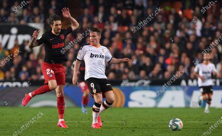 Kevin Gameiro of Valencia and Sime Vrsaljko of Atletico Madrid