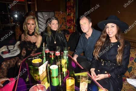 Stock Image of Christabel Milbanke, Lady Victoria Hervey, Angus Deayton and guest