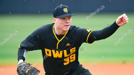 Kennesaw State player Max Ryan pitches during an NCAA baseball game against Cincinnati, in Kennesaw, Ga