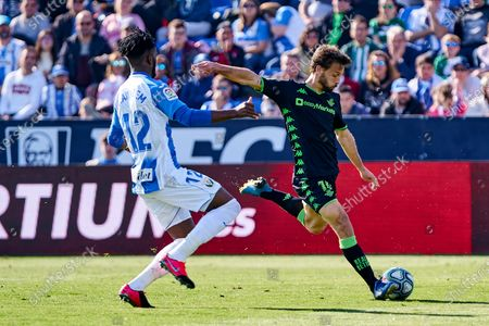 Chidozie Collins Awaziem of CD Leganes and Sergio Canales of Betis Balompie
