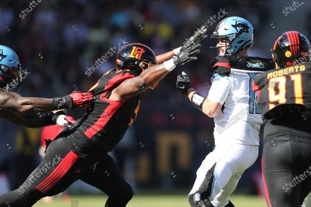 Dallas Renegades quarterback Landry Jones (12) gets sacked by LA Wildcats defensive end Cedric Reed (94) in the game between Dallas Renegades and Los Angeles Wildcats, Dignity Health Sports Park, Carson, CA. Peter Joneleit/ CSM