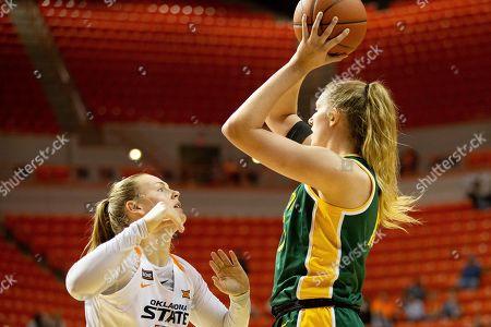 James Washington. Oklahoma State forward Natasha Mack (4) defends against Baylor forward Lauren Cox (15) during an NCAA college basketball game in Stillwater, Okla