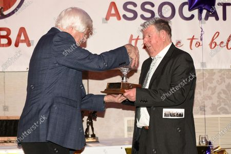Stock Photo of Ken Selleck (R) receives the Reg Gutteridge award for Services to Boxing Media from Colin Hart during the London Ex-Boxers Association Awards Lunch at the Grand Connaught Rooms on 16th February 2020