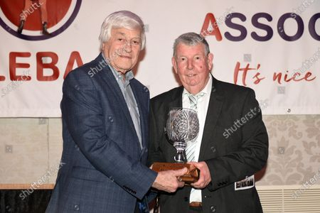 Ken Selleck (R) receives the Reg Gutteridge award for Services to Boxing Media from Colin Hart during the London Ex-Boxers Association Awards Lunch at the Grand Connaught Rooms on 16th February 2020
