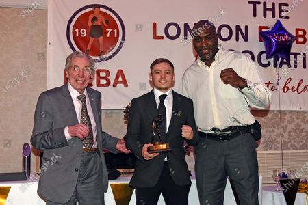 Stock Image of Sunny Edwards (C) receives the Johnny Kent Trophy for best London prospect from Peter Kent (L) and Derek Williams during the London Ex-Boxers Association Awards Lunch at the Grand Connaught Rooms on 16th February 2020
