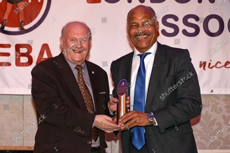Stock Photo of John Conteh receives the Guest of Honour trophy during the London Ex-Boxers Association Awards Lunch at the Grand Connaught Rooms on 16th February 2020