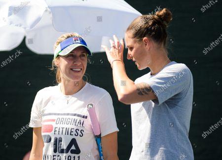 Olga Savchuk during practice with Karolina Pliskova at the 2020 Dubai Duty Free Tennis Championships WTA Premier tennis tournament.