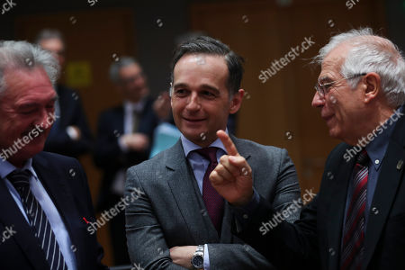 Heiko Maas, Jean Asselborn, Josep Borrell. European Union foreign policy chief Josep Borrell, right, talks to Germany's Foreign Minister Heiko Maas, center, and Luxembourg's Foreign Minister Jean Asselborn during an European Foreign Affairs meeting at the Europa building in Brussels, . A number of European Union countries are blocking a decision to resume a naval operation in the Mediterranean Sea over concerns that it might encourage migrants to set out from the Libyan coast in search of better lives in Europe, the EU's top diplomat said Monday