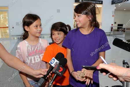 (L-R) Isla Dawson (8), Isabel Taylor (9) and Elizabeth Taylor (10) talk to the media after arriving from Christmas Island at Perth Airport in Perth, Australia, 17 February 2020. More than 200 Australians are due to fly home from Christmas Island after being quarantined in the former detention centre because of the coronavirus.